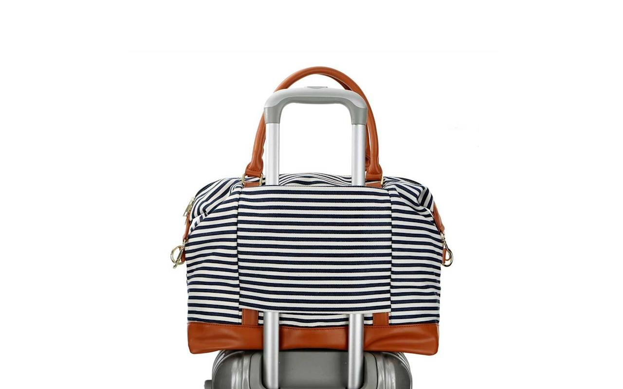 """<p>Headed somewhere warm? This canvas and faux leather weekender lends a chic summer vibe to your travels, thanks to its pretty marinière print.</p> <p>To buy: <a href=""""https://www.amazon.com/BAOSHA-Weekender-Overnight-Shoulder-Leather/dp/B0749KFTKR/ref=as_li_ss_tl?ie=UTF8&camp=1789&creative=9325&linkCode=as2&creativeASIN=B0749KFTKR&tag=travandleis07-20&ascsubtag=d41d8cd98f00b204e9800998ecf8427e"""" target=""""_blank"""">amazon.com</a>, $33</p>"""