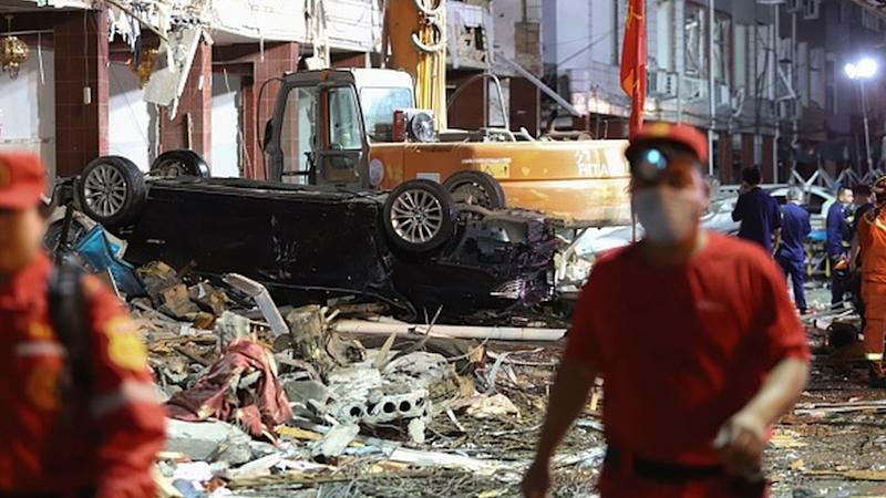 Damaged vehicles and buildings at the site of a tanker explosion near Wenling, in China's eastern Zhejiang province