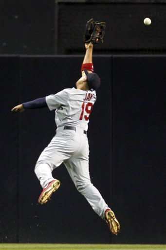St. Louis Cardinals center fielder Jon Jay (19) leaps for the ball on a run-scoring double by San Diego Padres' Logan Forsythe during the second inning of their baseball game in San Diego, Calif., Monday, Sept. 10, 2012. (AP Photo/Alex Gallardo)