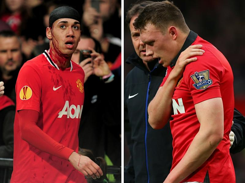 Chris Smalling (left) and Phil Jones face a long spell out of the Manchester United side
