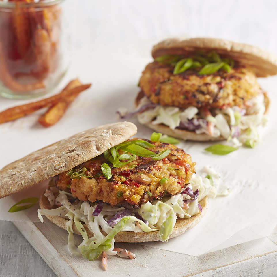<p>Salmon burgers on toasted rolls are served with tasty coleslaw and roasted carrots for a budget-friendly meal with plenty of vegetables.</p>