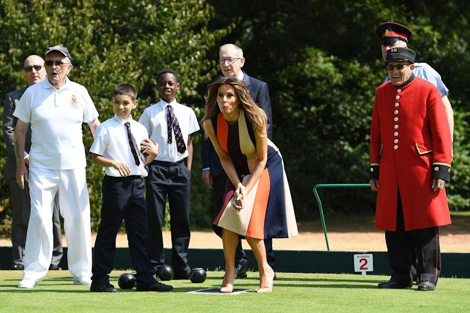 The First Lady enjoys a game of garden boules with the Chelsea Pensioners in London [Photo: Getty]