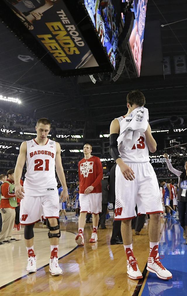 Wisconsin forward Duje Dukan, right, and guard Josh Gasser, left, walk off the court after an NCAA Final Four tournament college basketball semifinal game against Kentucky Saturday, April 5, 2014, in Arlington, Texas. Kentucky won 74-73. (AP Photo/Eric Gay)