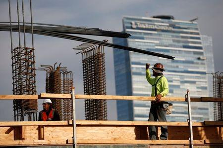 Men work on a construction site for a luxury apartment complex in downtown Los Angeles, California March 17, 2015. REUTERS/Lucy Nicholson