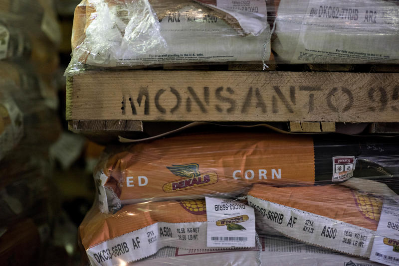 Germany's Bayer closes $63 billion Monsanto takeover, plans to drop US company's name
