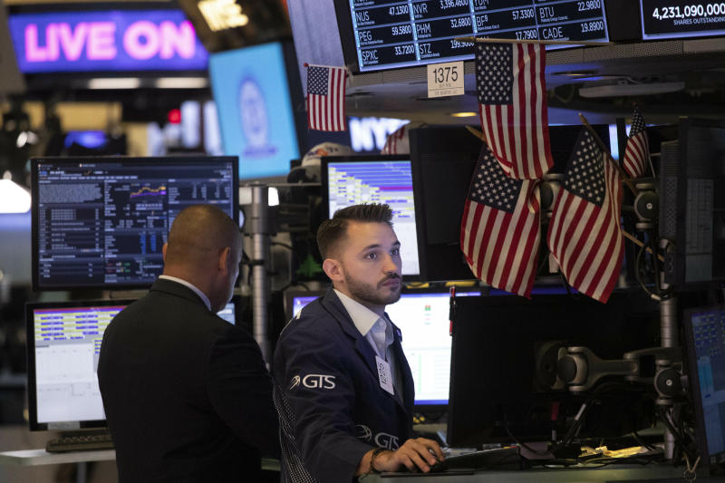 Traders work at the New York Stock Exchange, Friday, July 5, 2019 in New York. (AP Photo/Mark Lennihan)