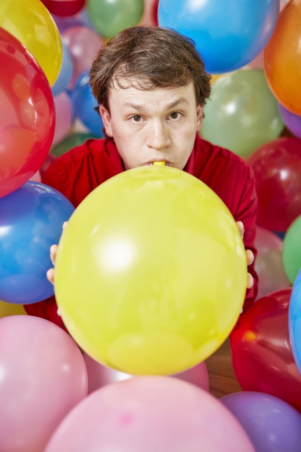 <p>With an incredible pair of lungs, Hunter Ewen blew up 910 balloons in 60 minutes. (PA) </p>
