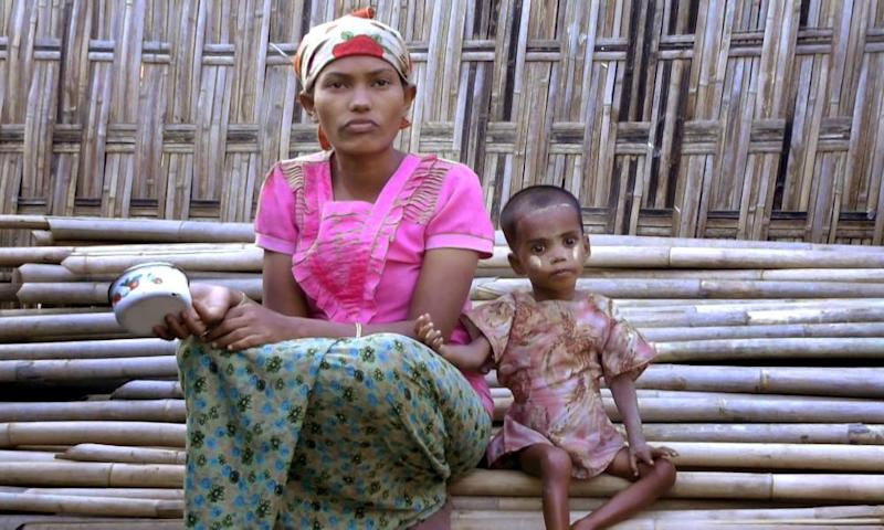 Rosmaida Bibi, right, who suffers from severe malnutrition, sits with her 20-year old mother Hamida Begum outside their makeshift shelter at the Dar Paing camp, north of Sittwe, Rakhine State, Myanmar.