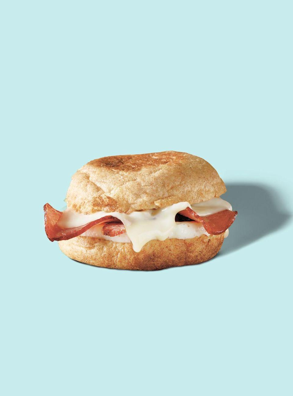"""<p><strong>Starbucks</strong></p><p>starbucks.com</p><p><a href=""""https://www.starbucks.com/menu/product/368/single?parent=%2Ffood%2Fhot-breakfast%2Fbreakfast-sandwiches-and-wraps"""" rel=""""nofollow noopener"""" target=""""_blank"""" data-ylk=""""slk:Order Now"""" class=""""link rapid-noclick-resp"""">Order Now</a></p><p><strong>Calories</strong>: 230</p><p><strong>Sodium</strong>: 550mg</p><p><strong>Total Carbohydrates</strong>: 28g</p><p><strong>Protein</strong>: 17g</p><p>Bacon isn't always synonymous with better for you, but in this case, Starbucks' turkey bacon sandwich contains around half the sodium of other sandwiches on the menu. This includes <a href=""""https://www.goodhousekeeping.com/health/diet-nutrition/a32958544/starbucks-impossible-breakfast-sandwich-calories/"""" rel=""""nofollow noopener"""" target=""""_blank"""" data-ylk=""""slk:the Impossible meat option"""" class=""""link rapid-noclick-resp"""">the Impossible meat option</a>, which has significantly more calories and salt — something that many may not realize at first. """"If you're actually following a stricter vegetarian routine, then I'd understand why the Impossible option may appeal to you — but if you're eating meat and just think that a faux option will be better for you, you're actually better off eating this instead,"""" Sassos explains. Plus, this is one of the menu's customizable breakfast sandwiches — meaning you can remove any of its components to your liking.</p><p><strong>Nutrition Lab Pro Tip: </strong>This option has less fiber than the chain's spinach egg-white wrap as it isn't made with any vegetables. Try adding <strong>a container of the chain's <a href=""""https://www.starbucks.com/menu/product/2122257/single?parent=%2Ffood%2Fsnacks-and-sweets%2Fspreads"""" rel=""""nofollow noopener"""" target=""""_blank"""" data-ylk=""""slk:avocado spread"""" class=""""link rapid-noclick-resp"""">avocado spread</a></strong>, which contains only 90 calories and 5g of fiber-rich carbohydrates.<br></p>"""