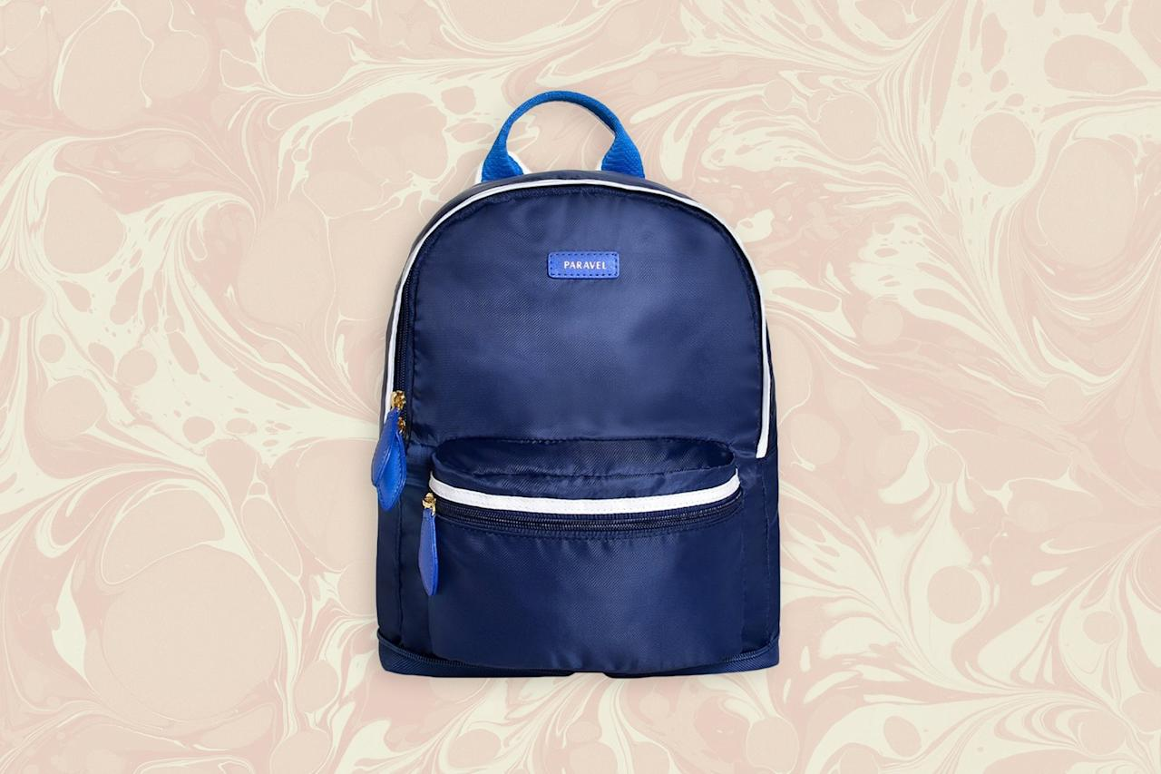 """<p>Ideal for everything from city excursions to last-minute souvenir shopping, <a href=""""https://www.cntraveler.com/story/paravel-fold-up-duffel-bag?mbid=synd_yahoo_rss"""">Paravel</a>'s lightweight backpack folds up so small that it will take up hardly any space in your suitcase—perfect for those of us who tend to buy too much on vacation. Bonus: It's crafted out of the brand's earth-friendly """"negative nylon,"""" which is made from recycled plastic water bottles.</p> <p><br> <strong>Buy now:</strong> $45, <a href=""""https://click.linksynergy.com/deeplink?id=mcB7N8bf3MY&mid=43748&u1=under50giftguide&murl=https%3A%2F%2Ftourparavel.com%2Fproducts%2Fmini-fold-up-backpack"""" rel=""""nofollow"""">tourparavel.com</a></p>"""