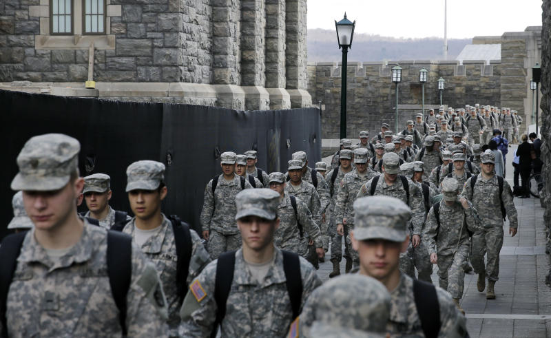 In this April 9, 2014, photo, columns of West Point cadets march to lunch at the United States Military Academy in West Point, N.Y. With the Pentagon lifting restrictions for women in combat jobs, Lt. Gen. Robert Caslen Jr. has set a goal of boosting the number of women above 20 percent for the new class reporting this summer. (AP Photo/Mel Evans)