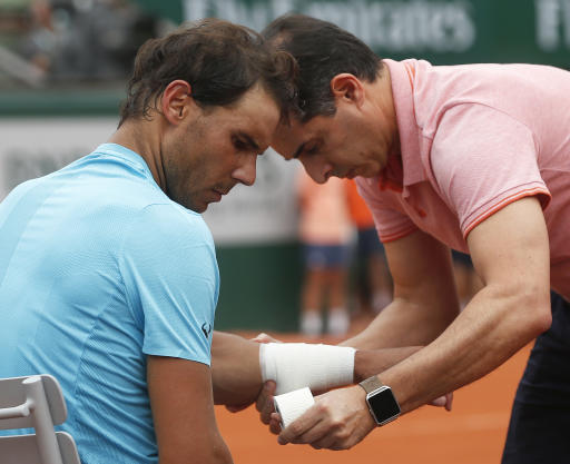 Nadal drops set but rain suspends French Open quarterfinal