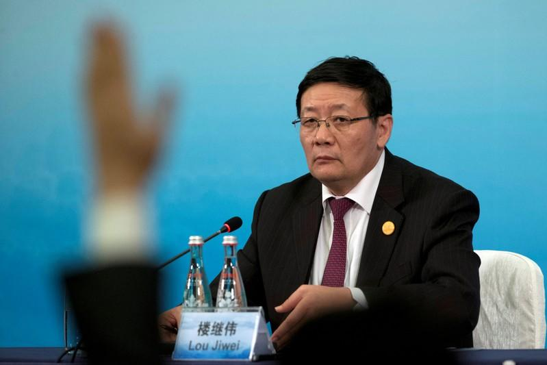 China's Minister of Finance Lou Jiwei attends a press conference held at the close of the G20 Finance Ministers and Central Bank Governors meeting in Chengdu in Southwestern China's Sichuan province