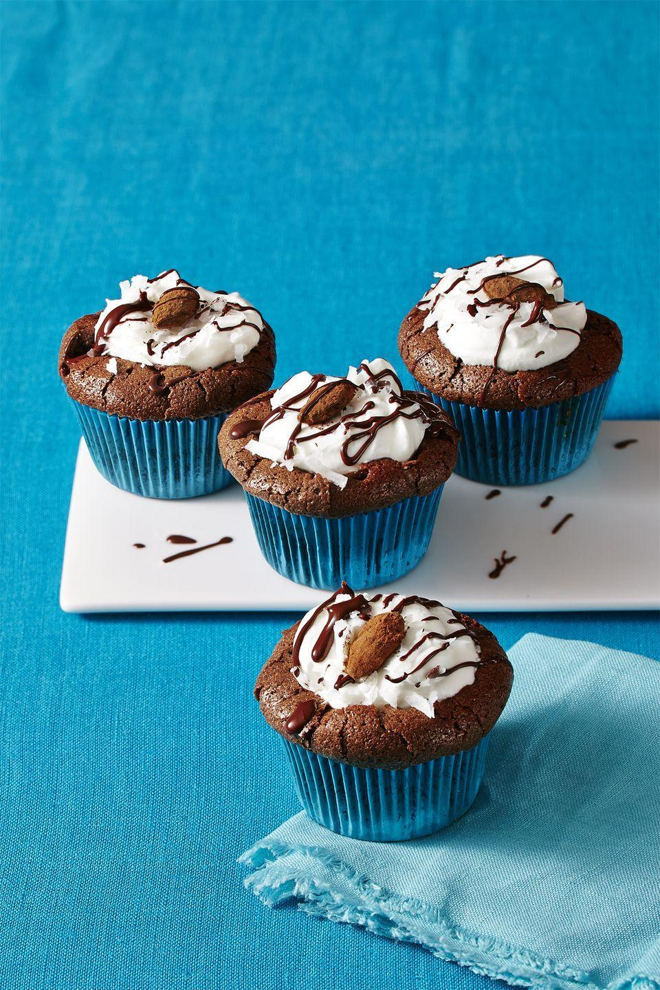 """<p>A beloved candy bar reimagined in cupcake form—you <em>might</em> want to make a double batch.</p><p><a href=""""https://www.womansday.com/food-recipes/food-drinks/recipes/a58122/almond-joy-cupcakes-recipes/"""" rel=""""nofollow noopener"""" target=""""_blank"""" data-ylk=""""slk:Get the recipe."""" class=""""link rapid-noclick-resp""""><strong>Get the recipe.</strong></a></p>"""