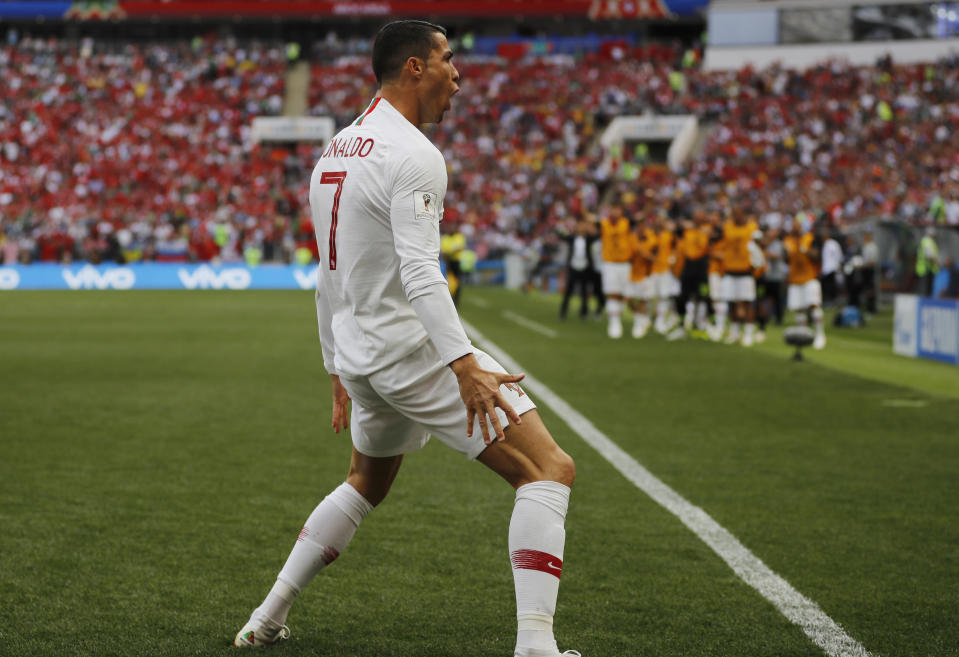 Cristiano Ronaldo celebrates his fourth goal of the 2018 World Cup, and the only one of Portugal's 1-0 victory over Morocco. (AP)