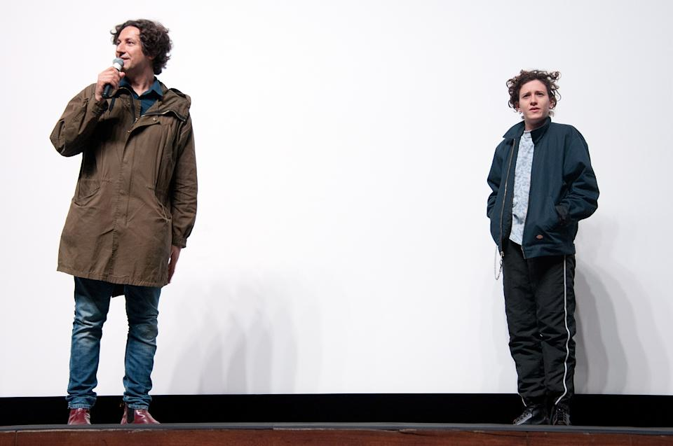 """LOS ANGELES, CA - MARCH 25:  Director Jonathan Glazer and composer Mica Levi attend the premiere of A24's """"Under The Skin"""" at The TheatreaAt Ace Hotel on March 25, 2014 in Los Angeles, California.  (Photo by Angela Weiss/Getty Images)"""