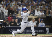 Los Angeles Dodgers' Will Smith (16) hits an RBI single during the fourth inning of a baseball game against the San Diego Padres Wednesday, June 23, 2021, in San Diego. (AP Photo/Denis Poroy)