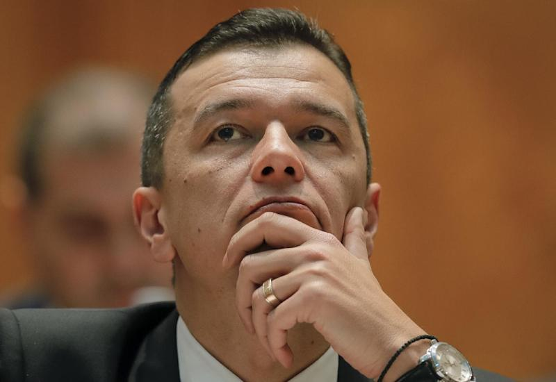 "Romanian Prime Minister designate Sorin Grindeanu waits before a parliament session, in Bucharest, Romania, Wednesday, Jan. 4, 2017. Grindeanu said Wednesday he wants to stop thousands of Romanians emigrating, build highways and encourage the consumption of local produce to create what he called ""a normal Romania."" (AP Photo/Vadim Ghirda)"