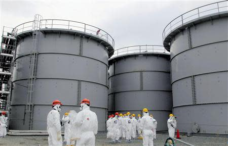 Tanks of radiation-contaminated water are seen at the Tokyo Electric Power Co (TEPCO)'s tsunami-crippled Fukushima Daiichi nuclear power plant in Fukushima prefecture in this file photo released by Kyodo on March 1, 2013. REUTERS/Kyodo/Files