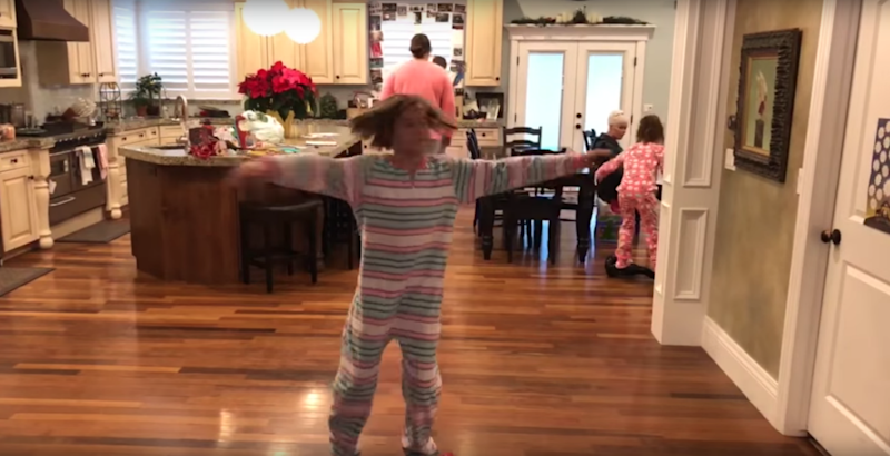 She decided to spin for the camera while on a hoverboard. Photo: YouTube/Kids Getting Hurt