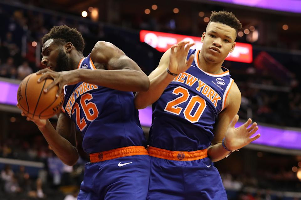WASHINGTON, DC - OCTOBER 01: Mitchell Robinson #26 of the New York Knicks and Kevin Knox #20 of the New York Knicks grab a rebound against the Washington Wizards during the first half of a preseason NBA game at Capital One Arena on October 01, 2018 in Washington, DC. NOTE TO USER: User expressly acknowledges and agrees that, by downloading and or using this photograph, User is consenting to the terms and conditions of the Getty Images License Agreement. (Photo by Patrick Smith/Getty Images)