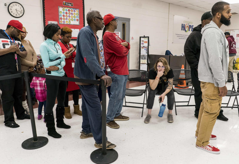 Long lines at the polls in Georgia on Tuesday were a reminder that voting in many minority communities is difficult, which may have something to do with the Republican state officials in charge. (The Washington Post via Getty Images)