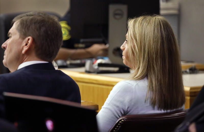 Former Dallas police Officer Amber Guyger listens to the prosecutions' closing arguments in her murder trial in the 204th District Court at the Frank Crowley Courts Building in Dallas, Monday, September 30, 2019. Guyger shot and killed Botham Jean, an unarmed 26-year-old neighbor in his own apartment last year. She told police she thought his apartment was her own and that he was an intruder. (Tom Fox/The Dallas Morning News via AP, Pool)