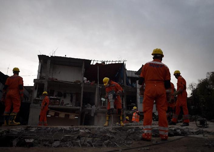 India's National Disaster Response Force personnel search for earthquake survivors as they clear rubble from a destroyed building in Kathmandu on April 28, 2015 (AFP Photo/Manan Vatsyayana)