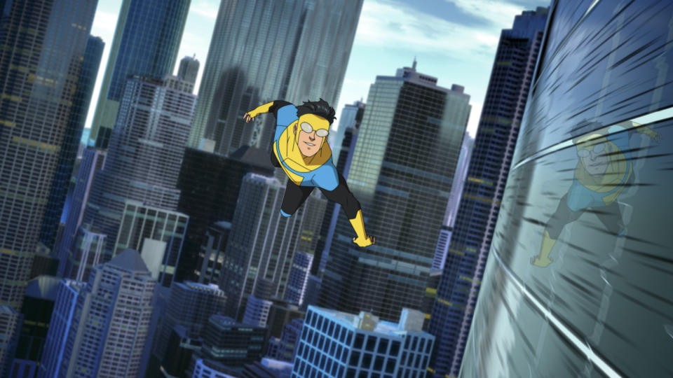 Mark Grayson aka Invincible (Steven Yeun) lives his best life hooning through the air, showing off his fancy superhero suit. Picture: Amazon Prime Video