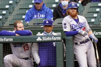 Los Angeles Dodgers' Max Muncy, left, manager Dave Roberts, center, and Justin Turner watches during the third inning of a baseball game against the Chicago Cubs in Chicago, Wednesday, May 5, 2021. (AP Photo/Nam Y. Huh)