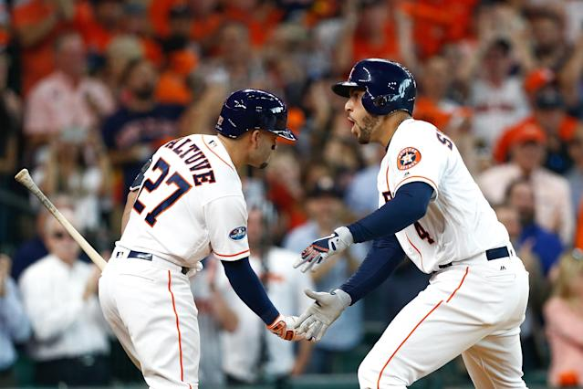 George Springer's home run built the Astros lead and earned a section free beer thanks to one fan. (Getty Images)