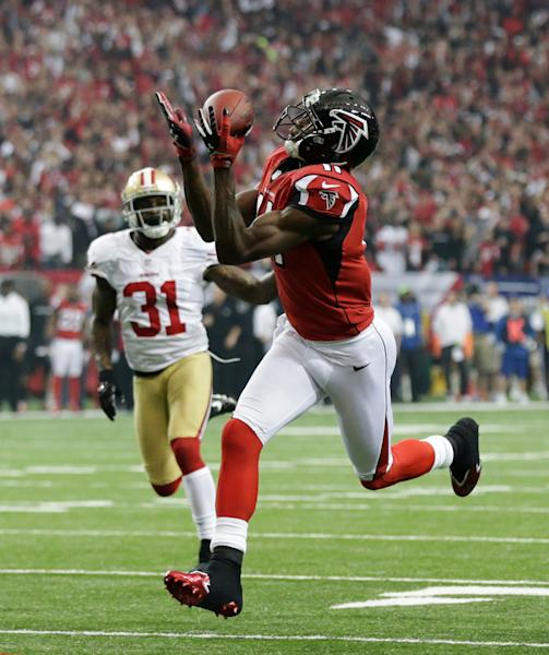 Atlanta Falcons' Julio Jones (11) catches a touchdown pass in front of San Francisco 49ers' Donte Whitner during the first half of the NFL football NFC Championship game Sunday, Jan. 20, 2013, in Atlanta. (AP Photo/Dave Martin)