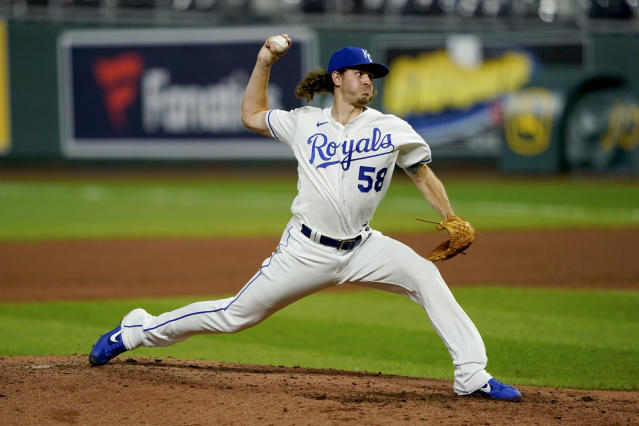Kansas City Royals relief pitcher Scott Barlow throws during the sixth inning of a baseball game against the Chicago White Sox Friday, July 31, 2020, in Kansas City, Mo. (AP Photo/Charlie Riedel)