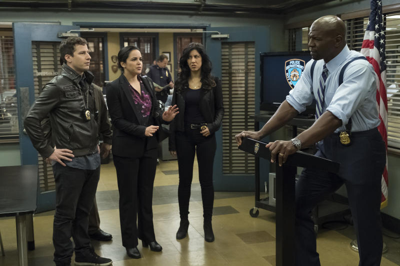 """BROOKLYN NINE-NINE -- """"Moo Moo"""" Episode 418 -- Pictured: (l-r) Andy Samberg as Jake Peralta, Melissa Fumero as Amy Santiago, Stephanie Beatriz as Rosa Diaz, Terry Crews as Terry Jeffords -- (Photo by: John P. Fleenor/Universal Television/NBCU Photo Bank/NBCUniversal via Getty Images)"""