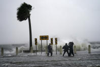 A news crew reports on the edge of Lake Pontchartrain ahead of approaching Hurricane Ida in New Orleans, Sunday, Aug. 29, 2021. (AP Photo/Gerald Herbert)