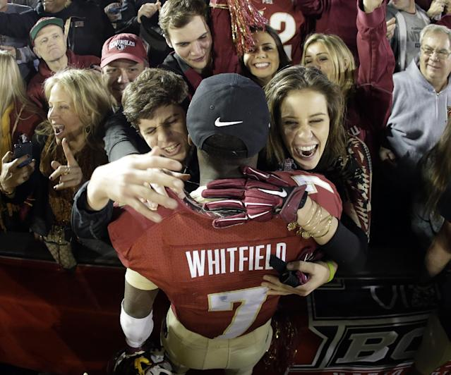 Florida State's Levonte Whitfield celebrates with fans after the NCAA BCS National Championship college football game against Auburn Monday, Jan. 6, 2014, in Pasadena, Calif. Florida State won 34-31. (AP Photo/Chris Carlson)