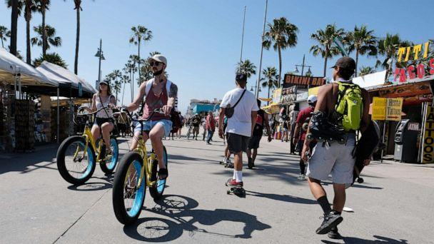 PHOTO: Cyclists ride along the Venice Beach boardwalk on May 25, 2020 in Venice, California. (Amanda Edwards/Getty Images)