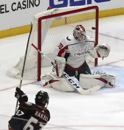 Anaheim Ducks center Rickard Rakell (67) puts the puck in the goal past Washington Capitals goalie Brandon Holtby (70) during the second period of an NHL hockey game in Anaheim, Calif., Tuesday, March 6, 2018. (AP Photo/Reed Saxon)