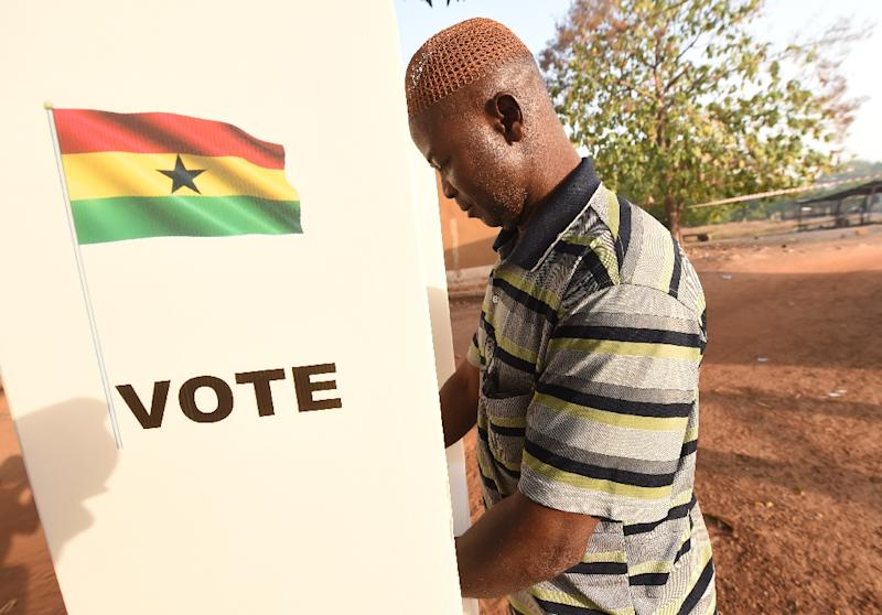 A man casts his vote in the presidential election in Bole district, northern Ghana, on December 7, 2016