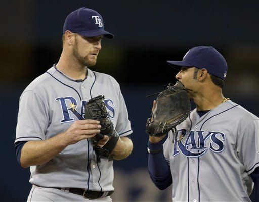 Tampa Bay Rays starting pitcher Jeff Niemann talks with first baseman Carlos Pena, right, in the third inning of a baseball game against the Toronto Blue Jays in Toronto on Tuesday April 17, 2012. (AP Photo/The Canadian Press, Frank Gunn)