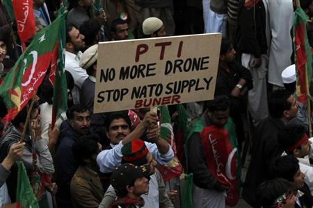 Supporters of Pakistan Tehreek-e-Insaf of Imran Khan protest during a rally to stop NATO supply routes into Afghanistan and drone attacks, in Peshawar