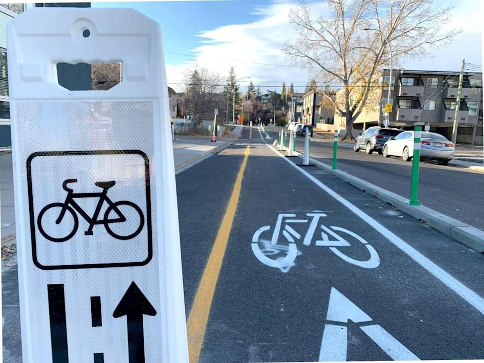 A new section of the 12th Avenue cycle track stretches between 14th Street S.W. and 19th Street S.W. and then northward to 10th Avenue, providing a direct connection for cyclists between the Beltline and the Bow River pathway.  (Mike Symington/CBC - image credit)