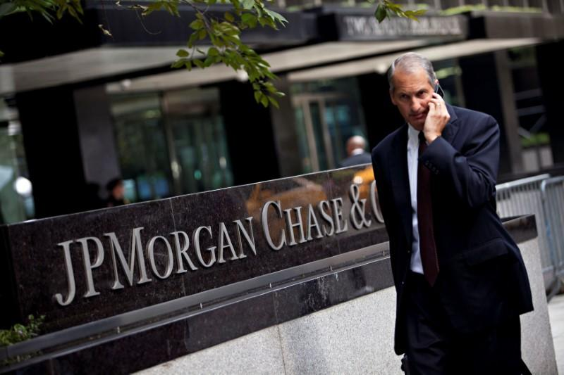 FILE PHOTO: Man walks past JP Morgan Chase's international headquarters on Park Avenue in New York