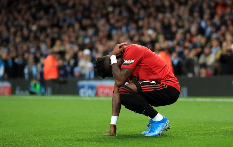 Manchester United's Fred reacts after being hit by thrown objects during the Premier League match at the Etihad Stadium, Manchester. (Photo by Mike Egerton/PA Images via Getty Images)