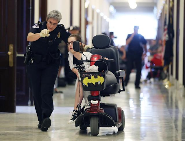 <p>U.S. Capitol Police remove a protester from in front of the office of Senate Majority Leader Mitch McConnell (R-KY) inside the Russell Senate Office Building on Capitol Hill, on June 22, 2017 in Washington. (Photo: Mark Wilson/Getty Images) </p>