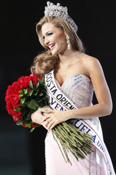 Miss Costa Oriente, Migbelis Castellanos smiles after being crowned as Miss Venezuela 2013 during the beauty pageant in Caracas, Venezuela, Thursday, Oct. 10, 2013. (AP Photo/Ariana Cubillos)