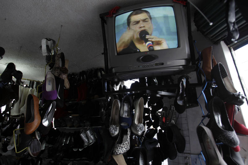 "In this Aug. 25, 2012 photo, a TV set at a shoe shop shows President Rafael Correa talking on his weekly program  ""Enlace Ciudadano,"" or ""Citizen Link,"" in Alangasi, Ecuador. To Correa, Australian-born Wikileaks founder Julian Assange is a truth-teller who deserves praise and protection as he knocks down the walls of government secrets.  But when it comes to Ecuador's opposition media, Correa says too many journalists serve special interests and have immense, unchecked power.  (AP Photo/Dolores Ochoa)"