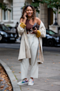 <p>Take your favourite trench to a whole other level with cut-out crop tops, rolled cuffs and colourful trainers.</p>