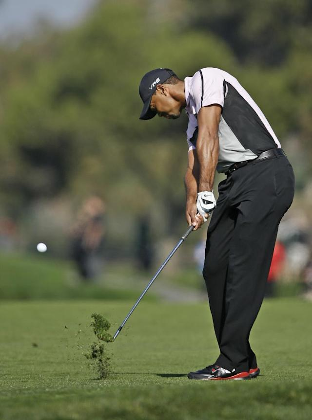 Tiger Woods hits to the second green on the south course at Torrey Pines during the first round of the Farmers Insurance Open golf tournament Thursday, Jan. 23, 2014, in San Diego. (AP Photo/Lenny Ignelzi)
