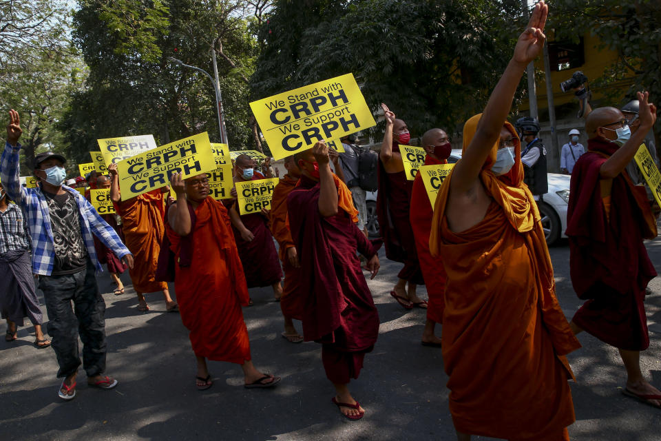 "Buddhist monks lead an anti-coup protest march in Mandalay, Myanmar, Saturday, Feb. 27, 2021. Myanmar security forces cracked down on anti-coup protesters in the country's second-largest city Mandalay on Friday, injuring at least three people, two of whom were shot in the chest by rubber bullets and another who suffered a wound on his leg. ""CRPH"" in the placards stand for ""Committee Representing Pyidaungsu Hluttaw."" (AP Photo)"
